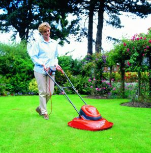 Flymo Turbo 400 Electric Hover Lawn Mower - Woman Mowing
