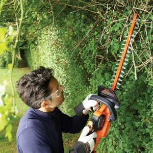 Black and DECKER 36 V Cordless Hedge Trimmer cutting hedges